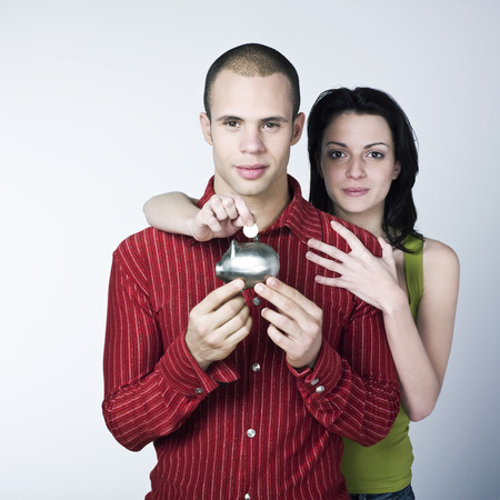 young couple saving on isolated background Stock Photo - 4006764
