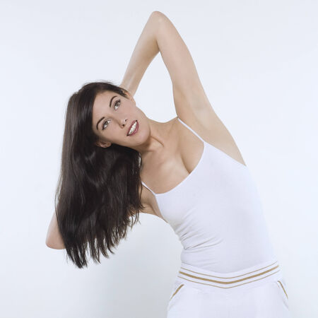 beautiful young woman on isolated background doing her workout Stock Photo - 3999365