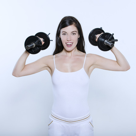 beautiful young woman on isolated background doing her workout Stock Photo - 3999352