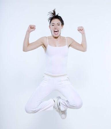 beautiful young woman on isolated background doing her workout Stock Photo - 3999347