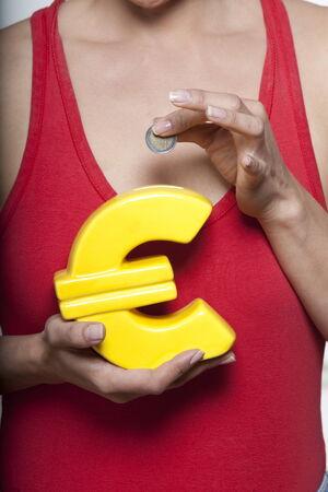 cute woman expressive on isloated white background holding euro money box Stock Photo - 5857841