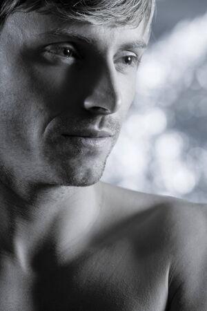 studio portrait of handsome blond man torso naked doing workout Stock Photo - 5978055