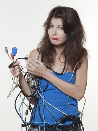 cable tangle: beautiful expressive woman on isolated white background in wire panic