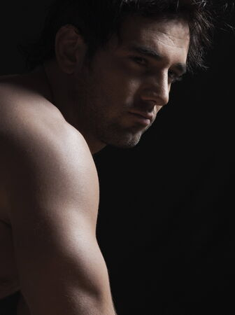 nude sport: Close-up of a naked young man looking sad LANG_EVOIMAGES
