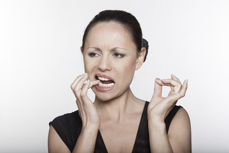grimacing: beautiful expressing woman portrait on isolated background toothache