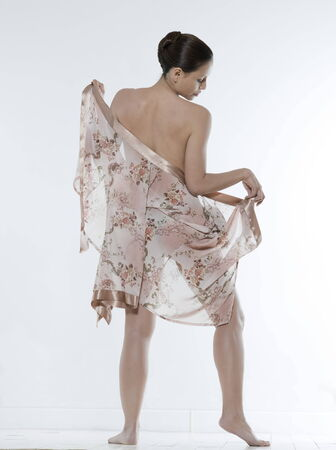 negligee: asian woman on isolated background looking at her body