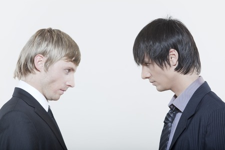 two male expressive young men on isolated background photo