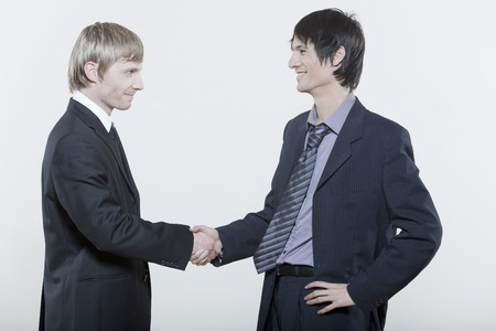 acceptation: two male expressive young men on isolated background