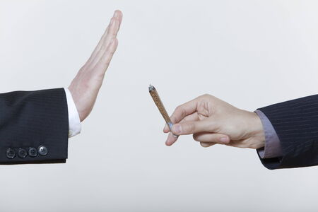 one hand stop gesture no to drugs cannabis marijuana cigarette isolated background