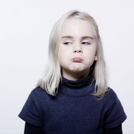 studio portrait of a caucasian cute sulk litle gir Stock Photo - 11644458