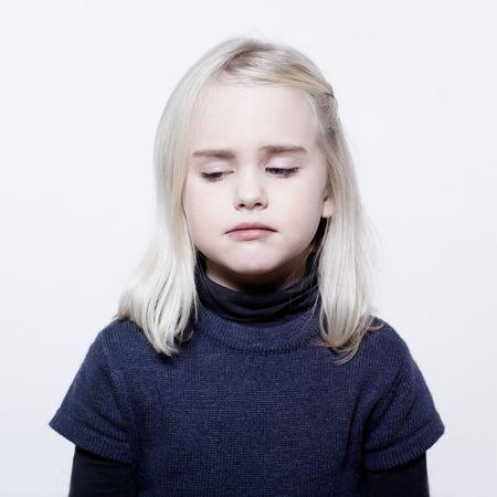 studio portrait of a caucasian cute sulk litle gir Stock Photo - 11644463