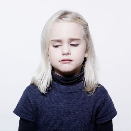 gir: studio portrait of a caucasian cute sulk litle gir LANG_EVOIMAGES