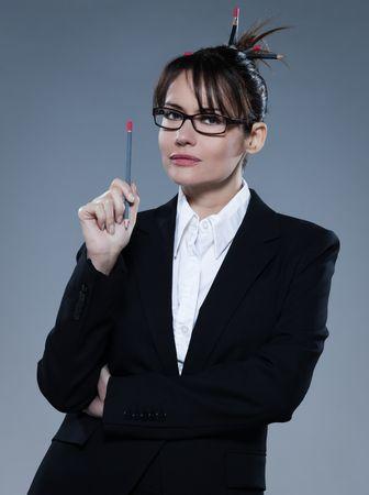 arrogancia: bella mujer de negocios en el fondo aislado LANG_EVOIMAGES