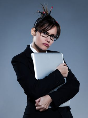beautiful business woman on isolated bacground embracing her laptop Stock Photo - 11644445