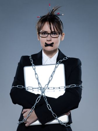 beautiful business woman on isolated bacground chained to  her laptop Stock Photo - 11644450