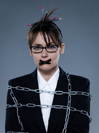 stifle: beautiful business woman chained on isolated background