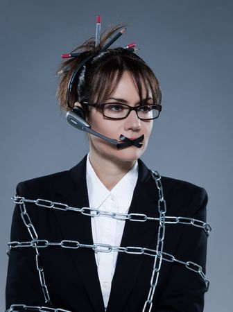impotent: beautiful business woman chained on isolated bacground with headset