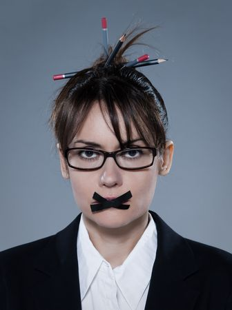 impotent: beautiful business woman on isolated bacground muzzle with headset LANG_EVOIMAGES