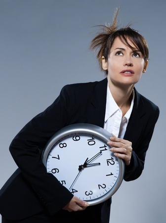 beautiful woman on isolated backgound holding a clock Stock Photo - 9823640