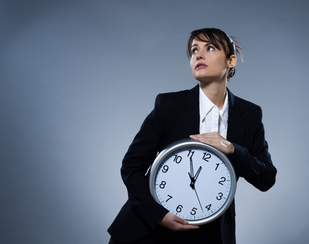 beautiful woman on isolated backgound holding a clock Stock Photo - 9800111