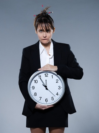 beautiful woman on isolated backgound holding a clock Stock Photo - 9823615