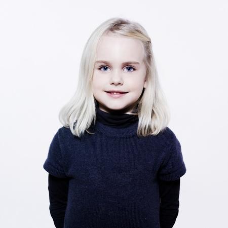 studio portrait of a caucasian cute litle gir Фото со стока