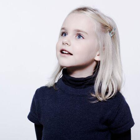 bewilder: studio portrait of a caucasian cute litle gir LANG_EVOIMAGES