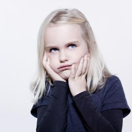 studio portrait of a caucasian cute sulk litle gir Stock Photo - 9823750