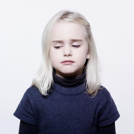 sulk: studio portrait of a caucasian cute sulk litle gir LANG_EVOIMAGES