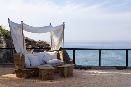 deck chair by the sea in a hotel resort in Kerala state india Stock Photo - 9823695