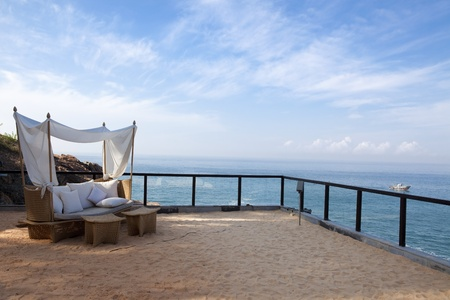 terrace house: deck chair by the sea in a hotel resort in Kerala state india