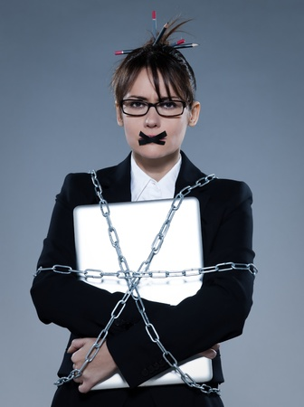 beautiful business woman on isolated bacground chained to  her laptop Stock Photo - 9823610