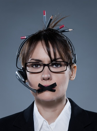 beautiful business woman on isolated bacground muzzle with headset Stock Photo - 9823681