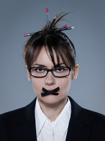 stifle: beautiful business woman on isolated bacground muzzle with headset LANG_EVOIMAGES