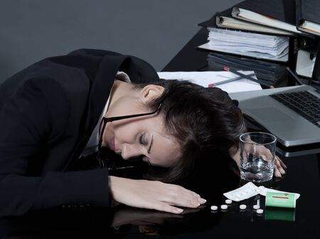 beautiful brunette business woman at her desk committes suicide Stock Photo - 9823761