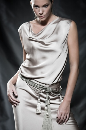 drapery: Fashion pictures of a beautiful woman wearing cream satin cocktail dress