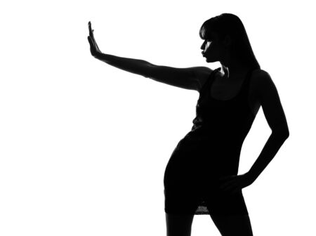 stylish sexy silhouette caucasian beautiful woman stop gesture on studio isolated white background Stock Photo - 9799923