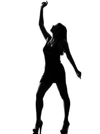 stylish silhouette caucasian beautiful woman dancing full length on studio isolated white background Stock Photo - 9799865
