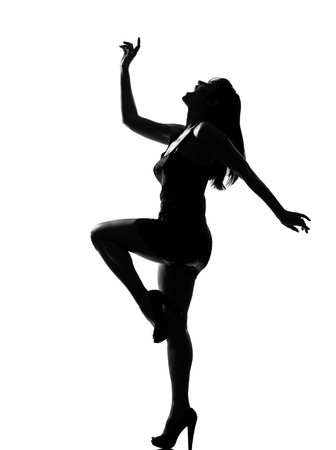 stylish silhouette caucasian beautiful woman dancing happy full length on studio isolated white background Imagens