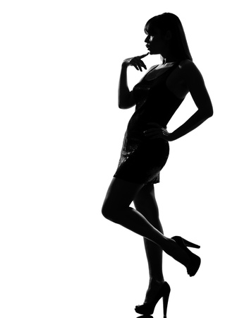 stylish silhouette caucasian beautiful woman pensive thinking full length on studio isolated white background Stock Photo - 9799888