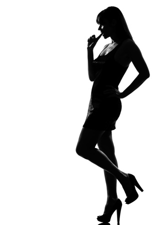 seductress: stylish silhouette caucasian beautiful woman thinking choosing seductress full length on studio isolated white background