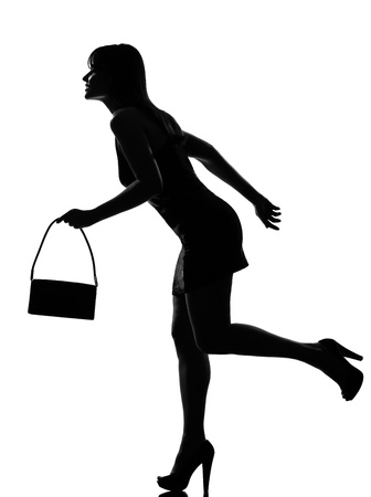 stylish silhouette caucasian beautiful woman running holding purse full length on studio isolated white background Stock Photo - 9799855