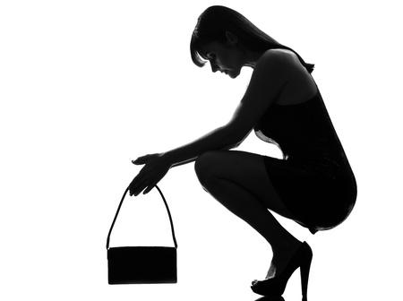 despair: stylish silhouette caucasian beautiful woman crouching thinkig despair full length on studio isolated white background