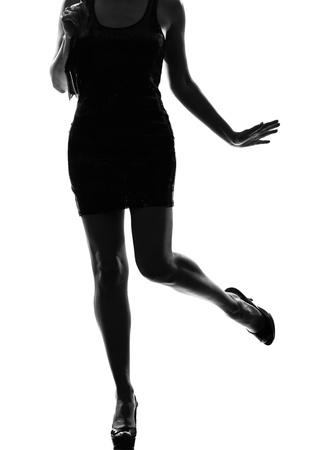 stylish sexy silhouette caucasian beautiful woman legs on studio isolated white background Stock Photo - 9800056