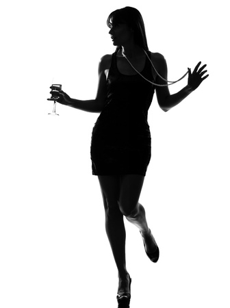 stylish silhouette caucasian beautiful woman partying drinking champagne flute glass cocktail full length on studio isolated white background Stock Photo - 9799945