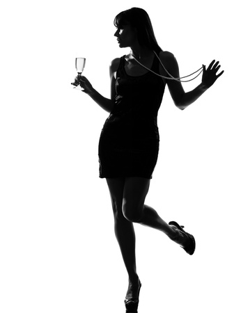 stylish silhouette caucasian beautiful woman partying drinking champagne flute glass cocktail full length on studio isolated white background Stock Photo - 9799889
