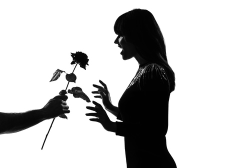 woman profile: man hand offering a flower rose stylish sexy silhouette caucasian beautiful woman on studio isolated white background LANG_EVOIMAGES