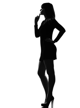 stylish silhouette caucasian beautiful woman full length thinking pensive on studio isolated white background Stock Photo - 9799829
