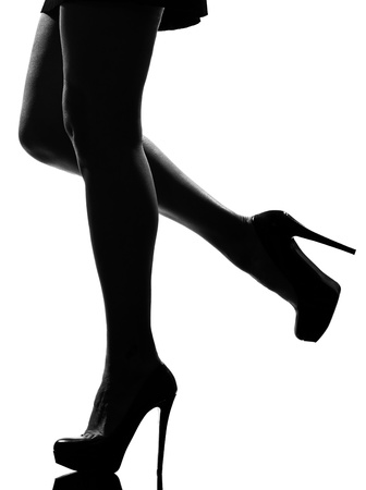 sexy legs: stylish silhouette caucasian beautiful woman legs shoes high heels  stileletto silhouette on studio isolated white background
