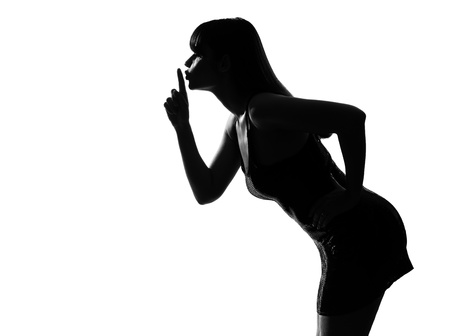 quiet adult: stylish sexy silhouette caucasian beautiful woman portrait husing silence secrecy on studio isolated white background LANG_EVOIMAGES
